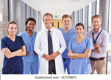 Portrait Of Medical Team Standing In Hospital Corridor