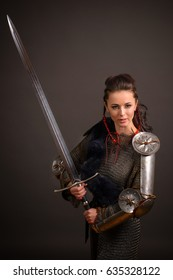 portrait of a medieval female knight in armour over grey background