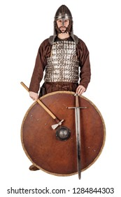 portrait medieval warrior in historical costume with sword and shield. image on white studio background. historical concept