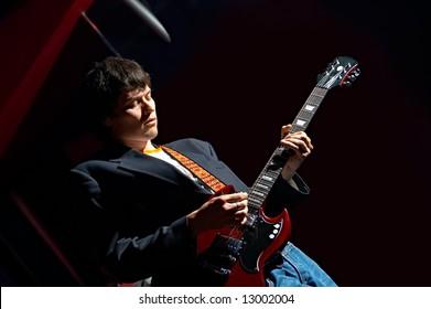 portrait men with guitar on black background