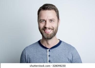 A Portrait of a men in studio gray background