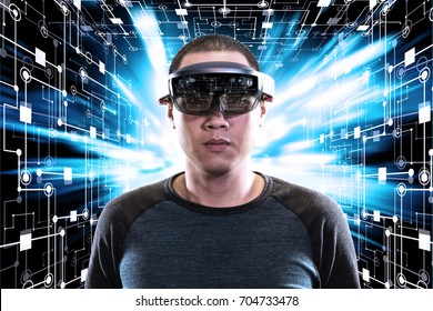 Portrait of men wearing hi tech glass - hololens with technology background