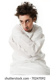 Portrait of mentally ill man wearing strait-jacket in isolation