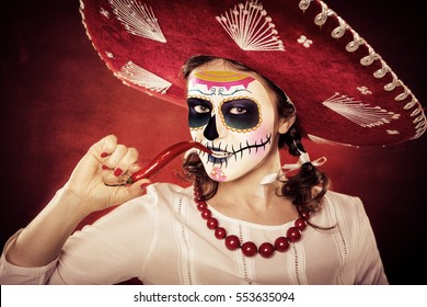 portrait of a mexican girl with La Muerte mask and sombrero