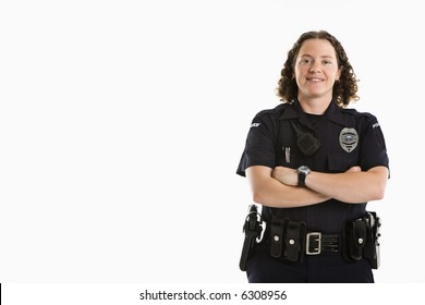 Portrait of mid adult Caucasian policewoman standing with arms crossed looking at viewer smiling.