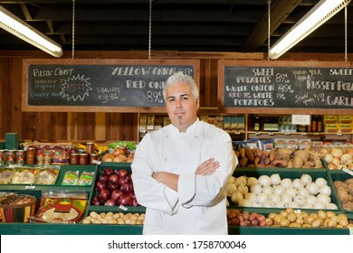 Portrait of a mid adult chef with arms crossed in farmer's market