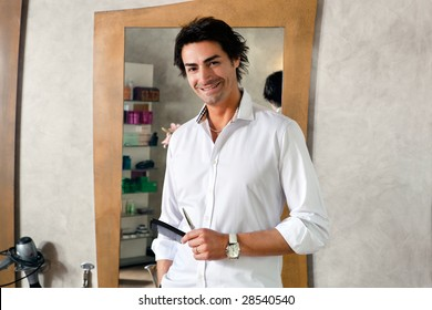 portrait of mid adult hairstylist looking at camera