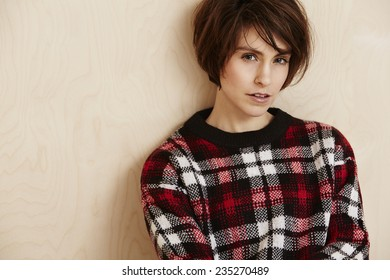 Portrait of mid adult woman in checked top