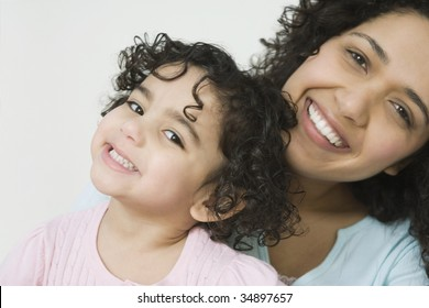 Portrait of a mid adult woman with her daughter smiling