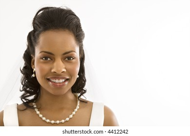 Portrait of a mid-adult African-American bride on white background.