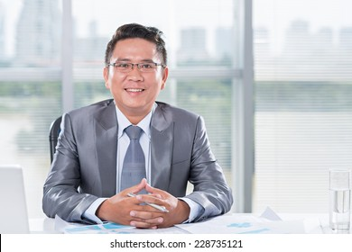 Portrait of a mid-adult businessman smiling at camera