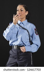 Portrait of a mid-aged policewoman talking on her CB radio