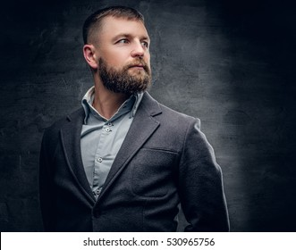 Portrait of middle age bearded male dressed in a wool grey suit.