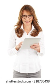 Portrait of middle age businesswoman touching digital tablet against white background.