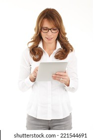 Portrait of middle age businesswoman using digital tablet while standing against white background.