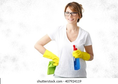 Portrait of middle age housekeeper holding hands cleaning products and ready to cleaning surface. Isolated on white background.