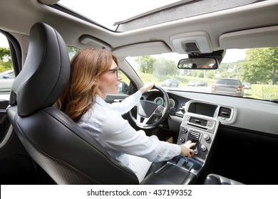 Portrait of middle age woman driving a car.