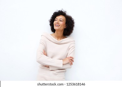 Portrait of middle age woman smiling with arms crossed against white background