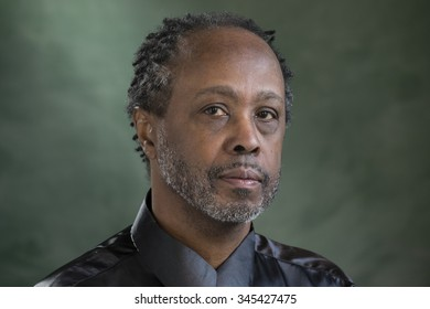 Portrait of a middle aged black male, looking into the camera