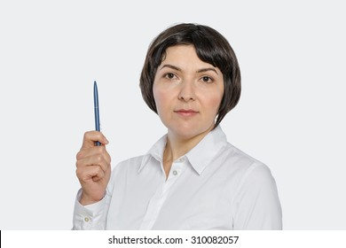 Portrait of middle aged business woman, confident, holding pen. Isolated, with copy space.