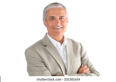 Portrait of a middle aged businessman with his arms folded over a white background. Man is smiling wearing a white shirt and sport coat.