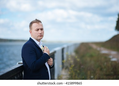 portrait of middle aged businessman walking in the nature