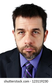Portrait of middle aged caucasian man with beard, looking sad or angry, could be disgruntled employee or depressed, stressed or overworked boss.