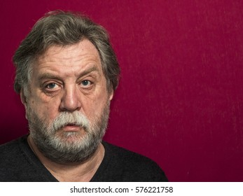 Portrait Of middle aged caucasian Man on red background