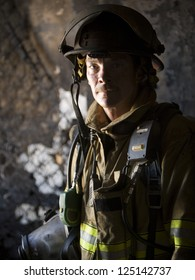 Portrait of a middle aged fire fighter in uniform