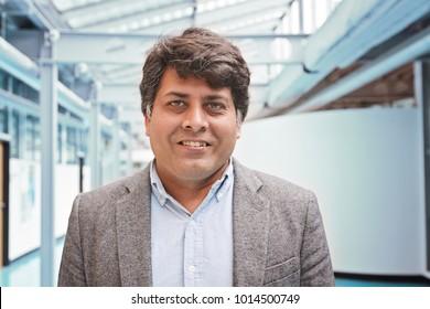 Portrait of middle aged indian businessman