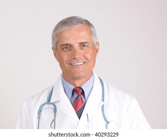 Portrait of a Middle Aged  Male Doctor in Lab Coat with Stethoscope