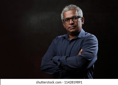 Portrait of Middle aged man in a dark background