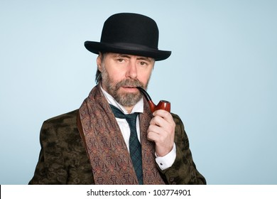 Portrait of middle aged man with a pipe.