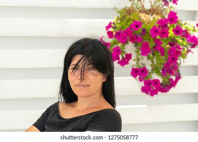 Portrait of a middle aged woman against a beautiful background.