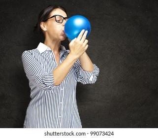 Mature women blow balloon