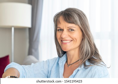 portrait of a middle aged woman with grey hair