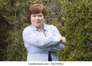 Portrait of middle aged woman with haircut outdoors in spring