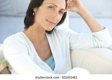Portrait of a middle aged woman relaxing at home