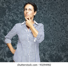 portrait of a middle aged woman thinking against a vintage background