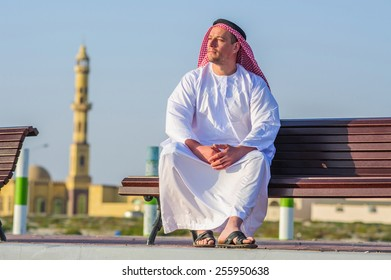 Portrait of Middle Eastern Arabic man in front of mosque.