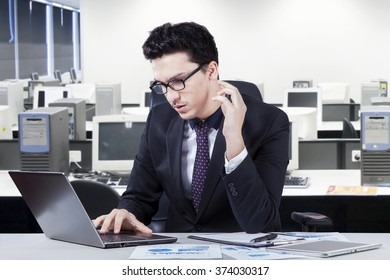 Portrait of a middle eastern businessman using laptop in the office and looks concentration doing his job