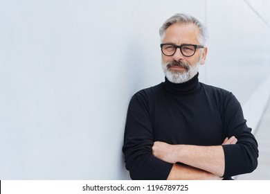 Portrait of middle-aged bearded man wearing black polo neck jumper