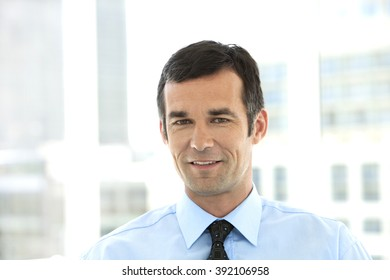 Portrait of a middle-aged businessman with blue shirt