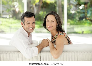 Portrait of middle-aged couple at home