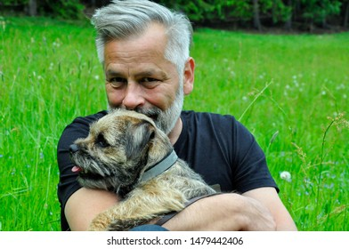 Portrait of a middle-aged man with his dog