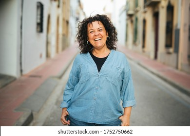Portrait of a middle-aged smiling woman  on the street