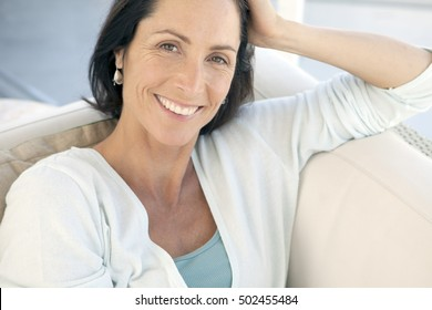 Portrait of a middle-aged woman relaxing at home