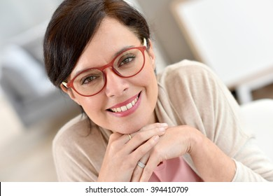 Portrait of middle-aged woman wearing eyeglasses