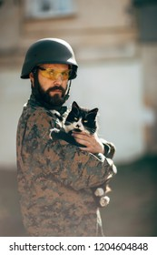 Portrait of a Military Man and Cats