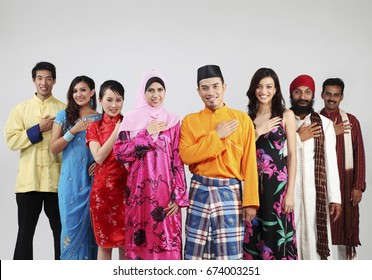 Portrait of mix races men and women with welcome hand gesture
